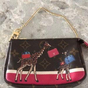 Louis Vuitton giraffe wristlet